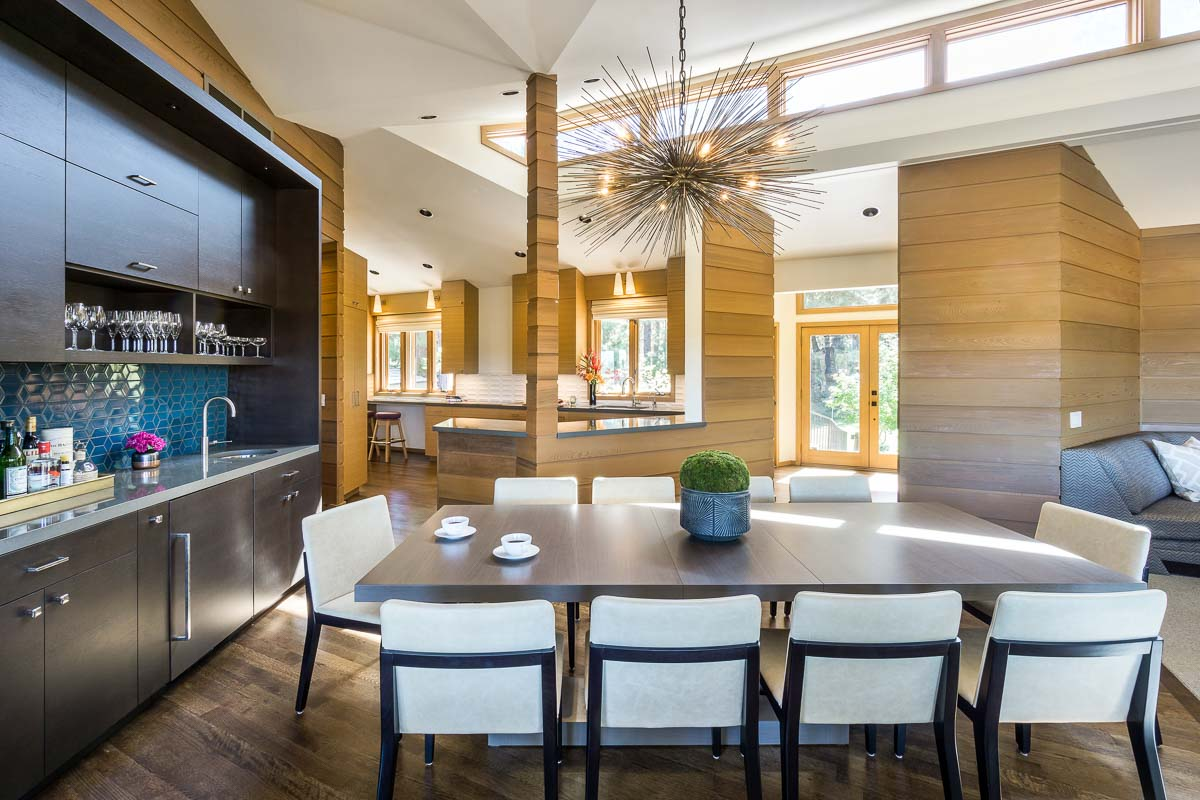 luxury kitchen and dining room with stunning light fixture