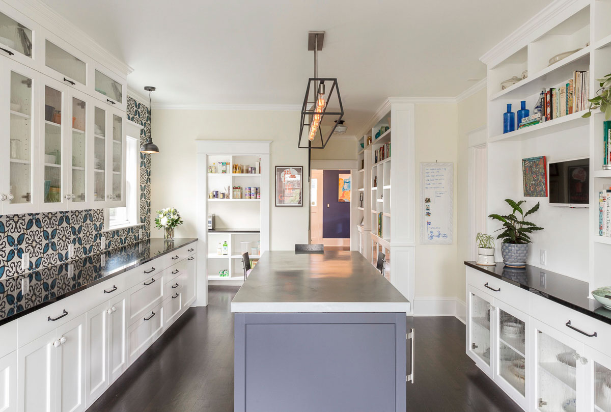 high end kitchen remodel with white cabinets and mosaic backsplash