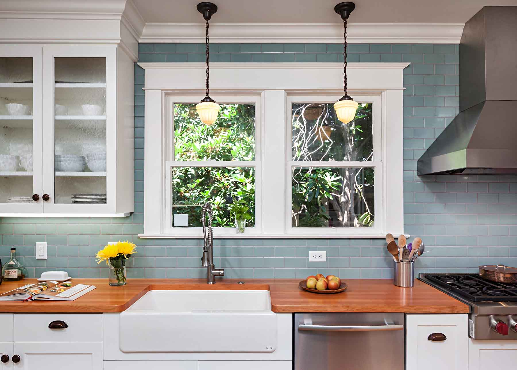 Portland Kitchen Remodel with white cabinets and trim and teal backsplash
