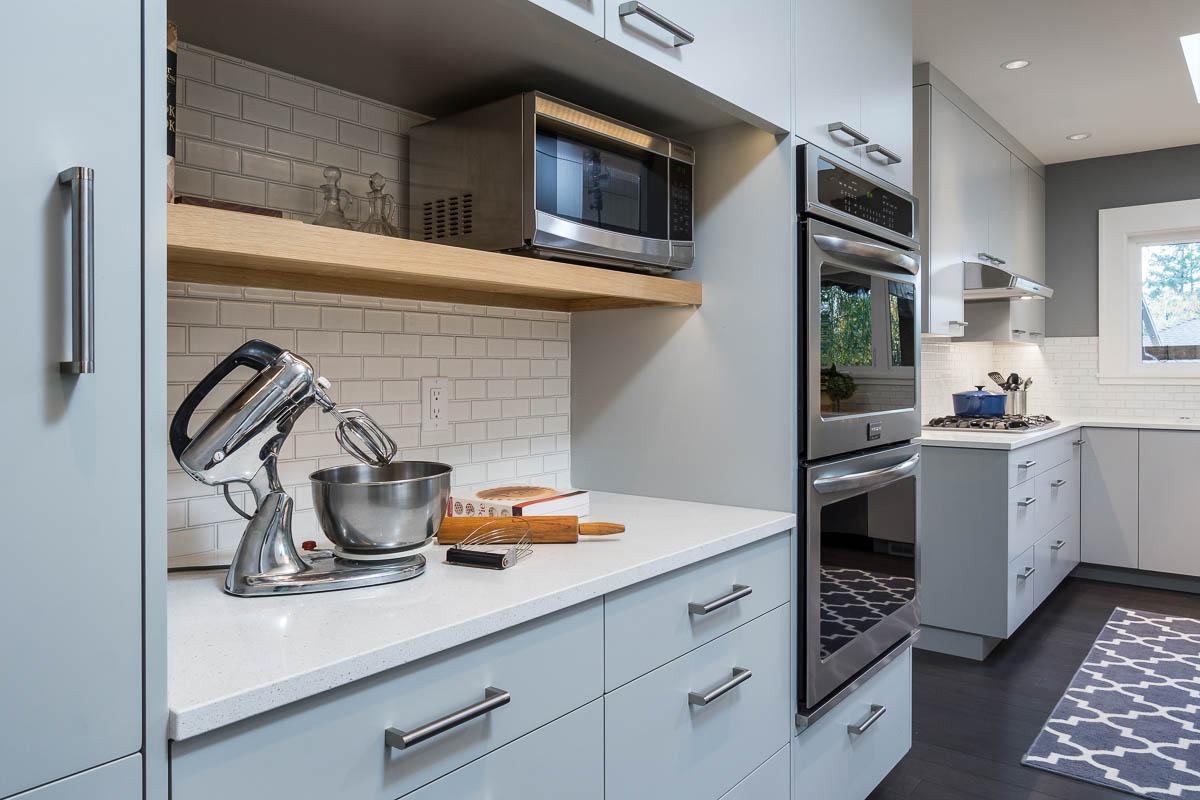 baby blue kitchen cabinets with white tile backsplash in luxury kitchen