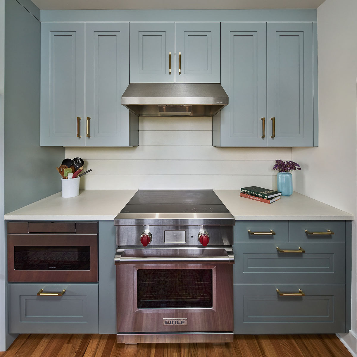 Darker blue-gray lower cabinets complement upper cabinets