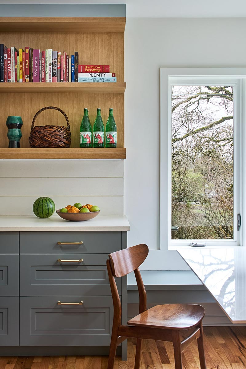 Cookbook shelves with natural wood stain match wood floor
