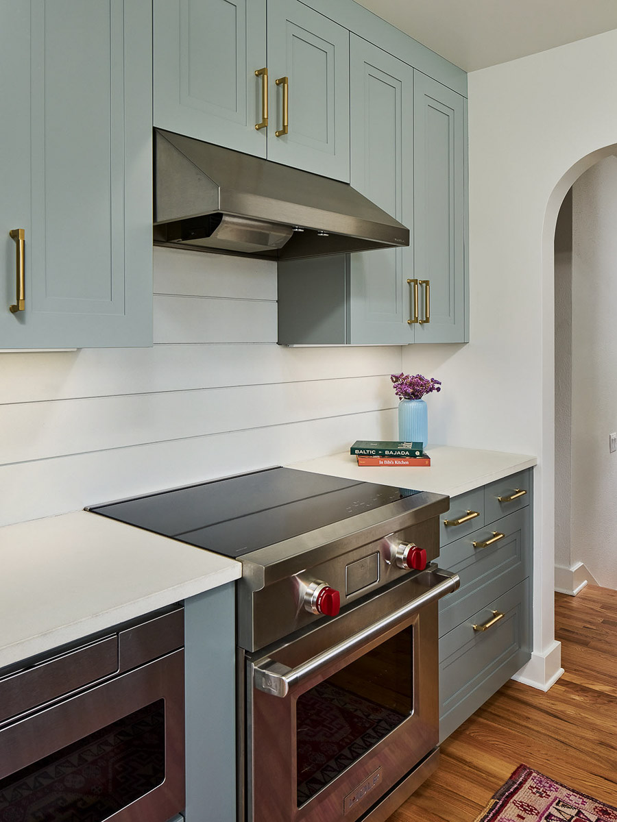 Modern nickel-finish oven and matching vent
