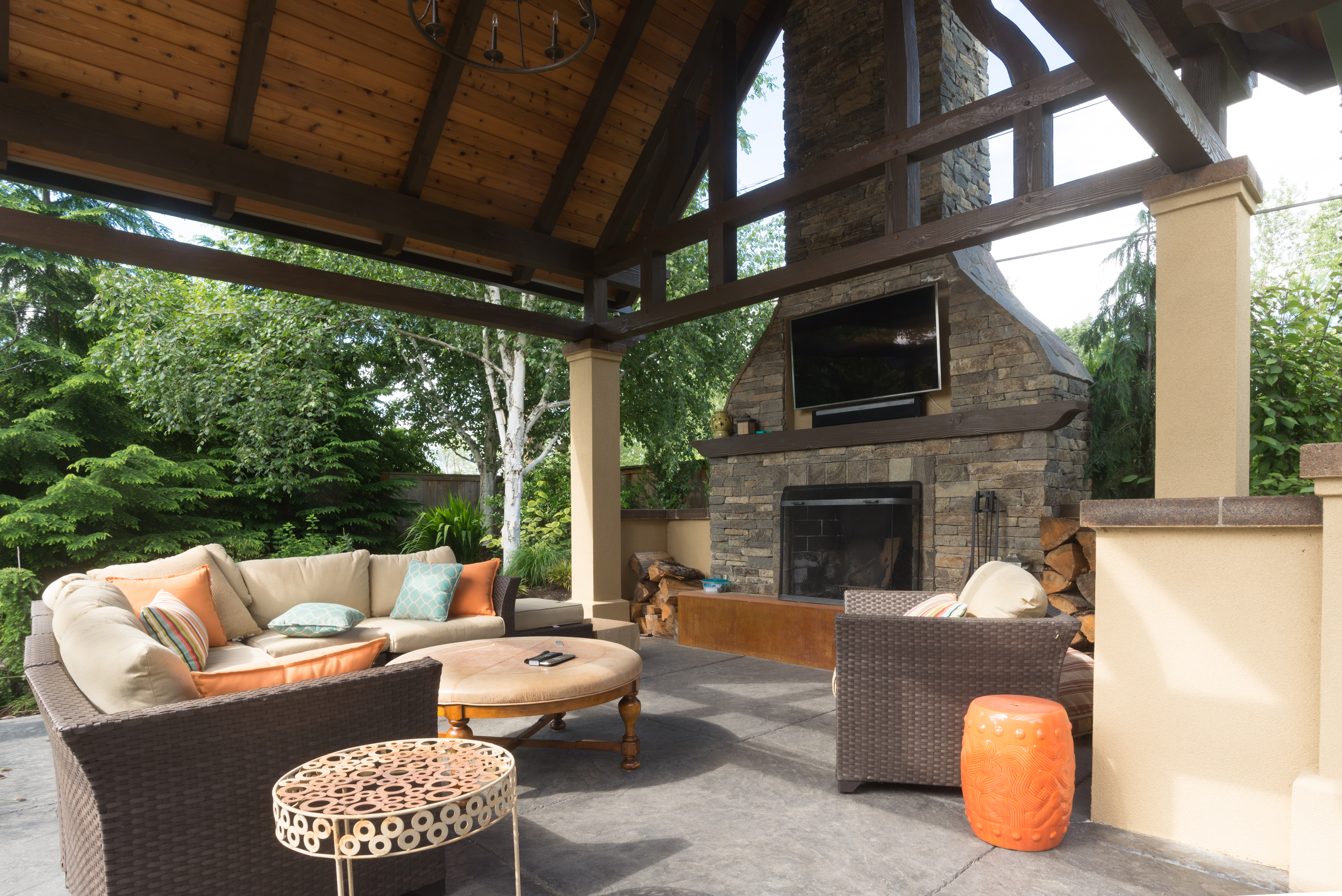 upscale outdoor terrace/room with comfortable furniture and big fireplace