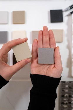 person holding two different colored squares